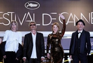Director Leos Carax and cast members pose during red carpet arrivals for the film Holy Motors in competition at the 65th Cannes Film Festival