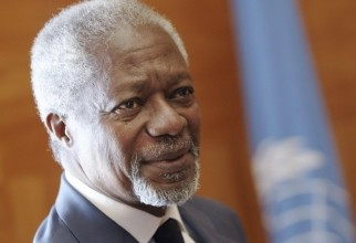 The Joint Special Envoy for Syria Annan waits for a guest before a meeting at the UN in Geneva