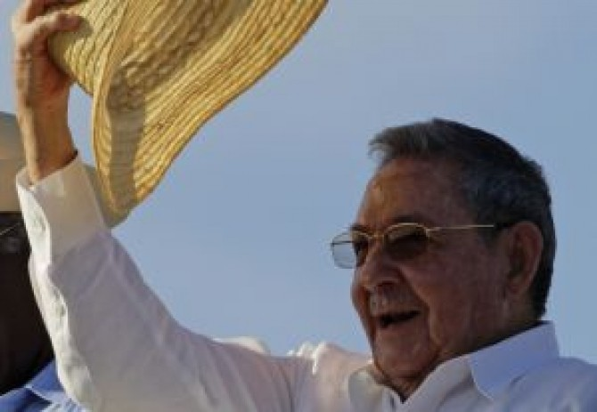 Cuba's President Raul Castro raises his hat at the May Day parade in Havana's Revolution Square