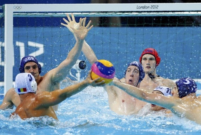 Romania's Tiberiu Negrean shoots at goal during their men's preliminary round Group B water polo match against Britain at the Water Polo Arena during the London 2012 Olympic Games