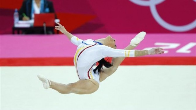 Catalina Ponor of Romania competes in the floor exercise during the women's gymnastics qualification in London