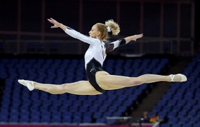 Sandra Raluca Izbasa of Romania practices on the floor during a gymnastics training session at the North Greenwich Arena before the start of the London 2012 Olympic Games
