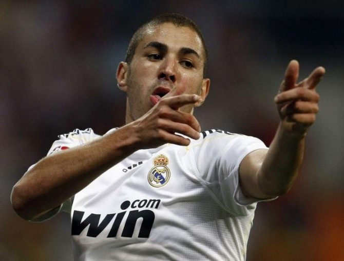 Real Madrid's Benzema celebrates after scoring during their Spanish first division match in Madrid
