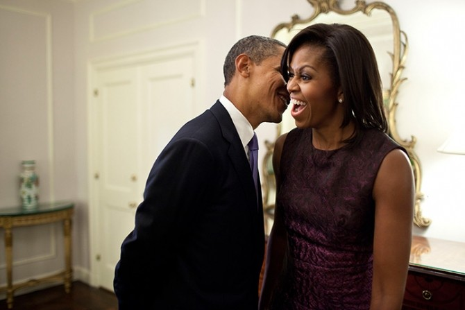 2011: Barack Obama whispers to Michelle Obama
