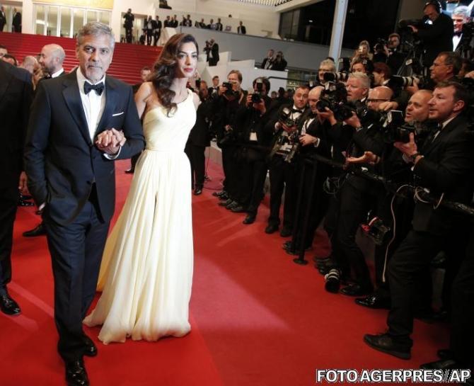 Cannes 2016. George Clooney alături de  Amal Clooney, soția sa