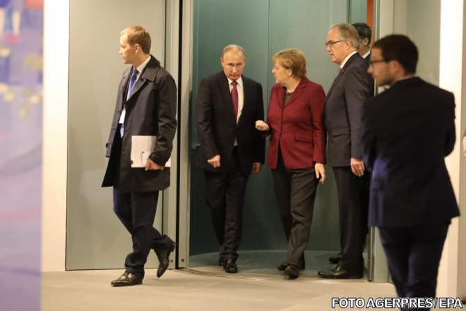 Vladimir Putin și Angela Merkel
