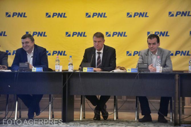 Fotografie realizată când Klaus Iohannis era președintele PNL, iar Ludovic Orban vicepreședinte