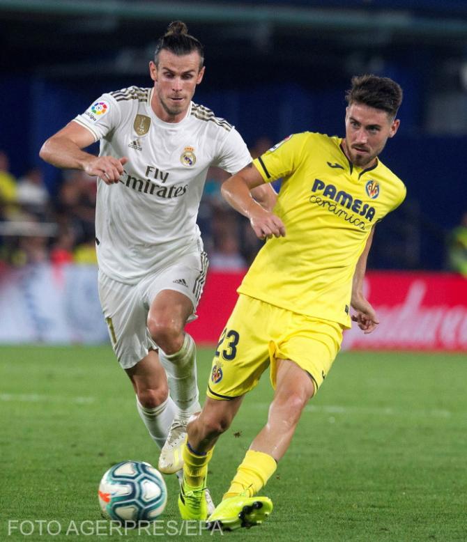 Gareth Bale în duel cu Moi Gomez