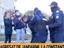 Protest Constanța. Bărbat pus la pământ și încătușat de jandarmi