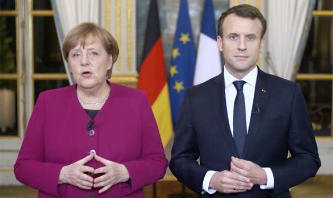 Emmanuel Macron şi  Angela Merkel şi-au exprimat vineri sprijinul în favoarea preşedintelui ucrainean Volodimir Zelenski