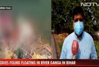 Zeci de cadavre ale unor persoane presupus decedate de COVID-19 au eşuat pe malurile fluviului Gange în India / Video