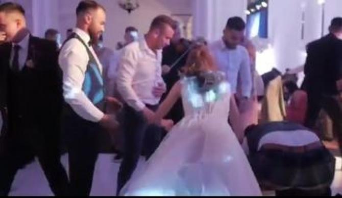 De la BAL, la SPITAL. Un mire și-a fracturat coloana după ce a fost scăpat din brațe de nuntași / Foto: Captură video Bihorjust
